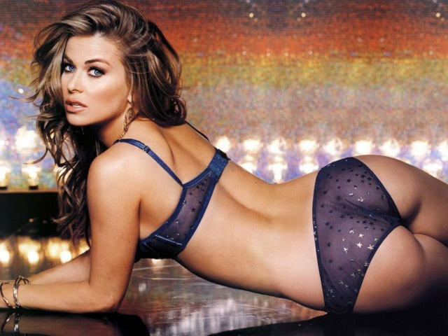 Carmen Electra - she's exactly my height and I had my boobies modeled after hers haha. Seriously, I took her pic to my surgeon. :-p
