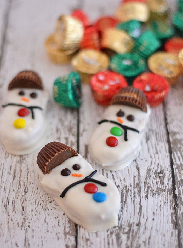 Need a last minute holiday treat but don't have a ton of time on your hands?  These Reese's Capped Snowmen Cookies are super easy to make