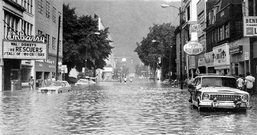 Shown is a view of Main Street in downtown Johnstown, Pa., on July 20, 1977, after floodwaters began to recede. The flood left 85 people dead, affected more than 7,300 families in seven counties and destroyed homes, businesses, dams, roads and bridges.(AP Photo, File)