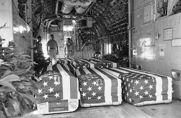 Flag-draped coffins of eight American Servicemen killed in attacks on U.S. military installations in South Vietnam, on February 7, are placed in transport plane at Saigon, February 9, 1965, for return flight to the United States. Funeral services were held at the Saigon Airport with U.S. Ambassador Maxwell D. Taylor and Vietnamese officials attending. (AP)