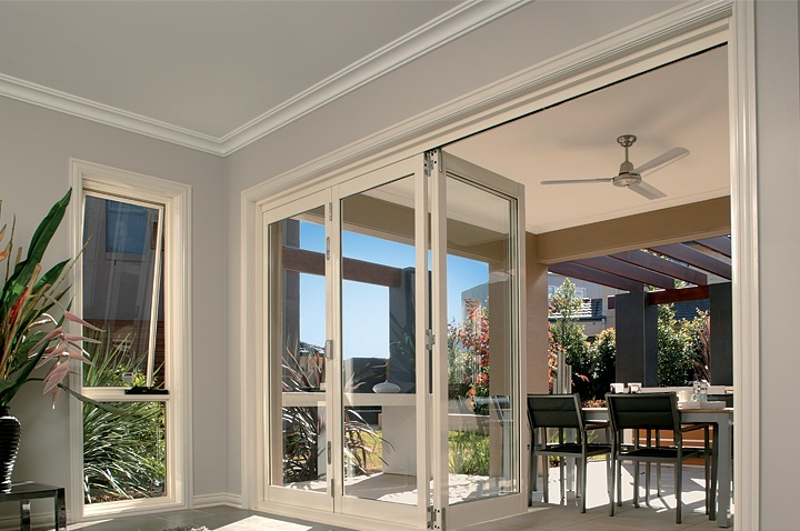 Alfresco bi-fold door system in white aluminum. Perfect for outdoor entertaining. Supplied by Kit King.