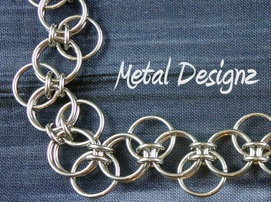 Interesting twist on a parallel or helm pattern, use the free ring to split the two small rings.  Want to try this!
