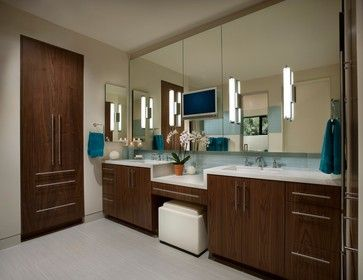 Double-sink bathroom vanity with makeup counter. Mirrored ...