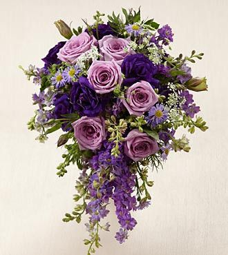 The FTD® Lavender Garden™ Bouquet is blooming with majestic charm, set to add that extra touch to your wedding style. Lavender roses are offset by purple larkspur, purple double lisianthus, lavender m