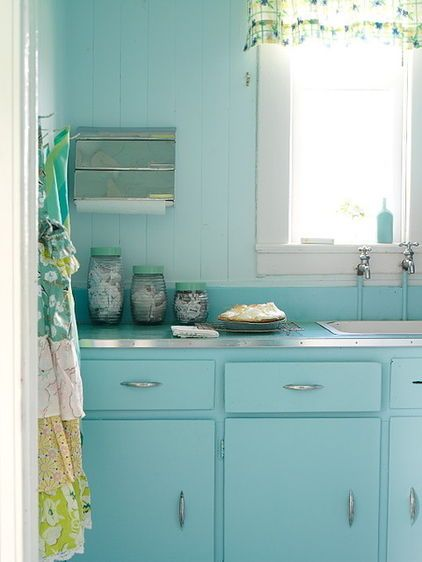 Wash your kitchen in soothing shades of a single hue for for Blue washed kitchen cabinets