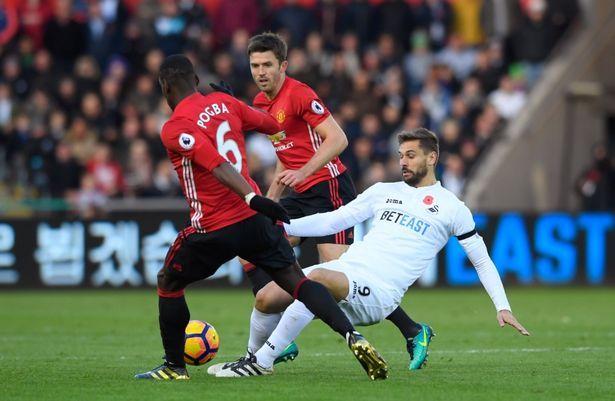 Pogba makes a tackle on Fernando Llorente