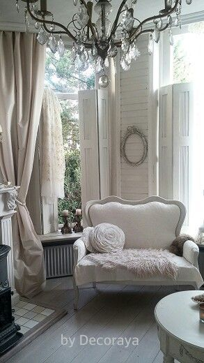 AVA - mismatched furniture in neutral shades of tone on tone whites...