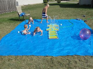 """Homemade splash pad in the backyard. Brilliant for my yard which is not """"run through the sprinkler with bare feet"""" quality."""