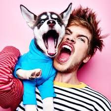 Joey Graceffa and his new dog wolf sharing a moment.