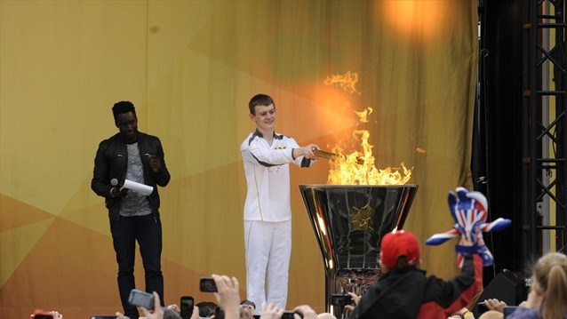 Torchbearer Phil Fuller lights the Cauldron at the end of Day 45 of the Torch Relay in Leicester.