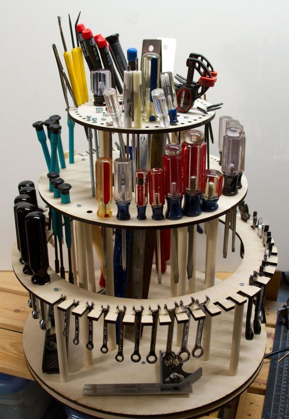 (Tools are shown for display only, this listing is for the rotating tool shelf only.) See it in action: <https://vimeo.com/157803201>. This is a rotating tool stand with slots and holes for tools of various sizes. There is also a hollow in the top shelf for storing things like 16 rulers. It weighs about 7 pounds and has a smooth bottom. The fittings on the top shelf are 5mm and 7.5mm diameter holes. The fittings on the 2nd shelf down: - Sets for Metric and SAE Allen wr...