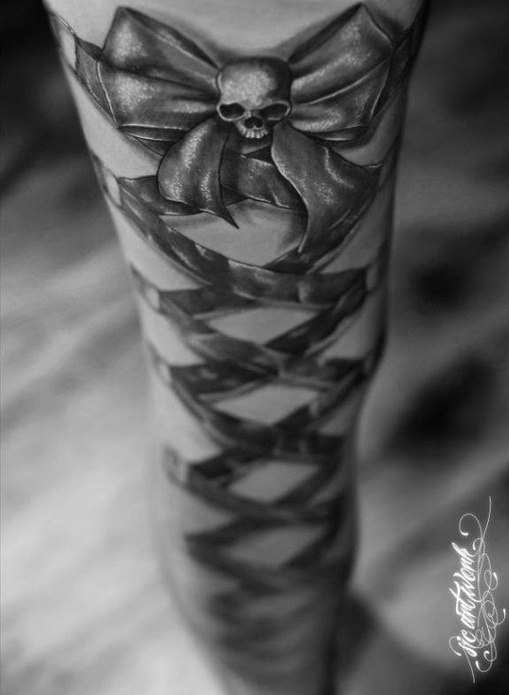 Skull & Bow Ribbon Tattoo this would be really cool to get down my arm as some point