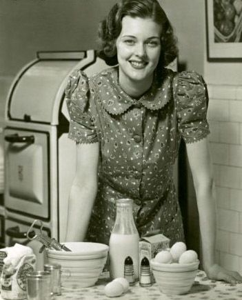 Happy in the kitchen in the 1940's - anyone else think this woman looks like…