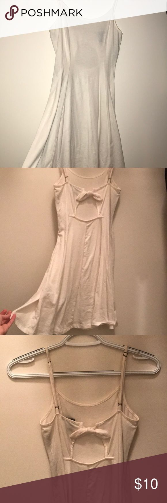Light Cream Spaghetti Strap Summer Dress Worn once, hugs the waist and flows at the thighs. It makes the figure look so nice and gives an hourglass look. Also has an opening at the back with a bow, so cute for spring and summer. Forever 21 Dresses Mini
