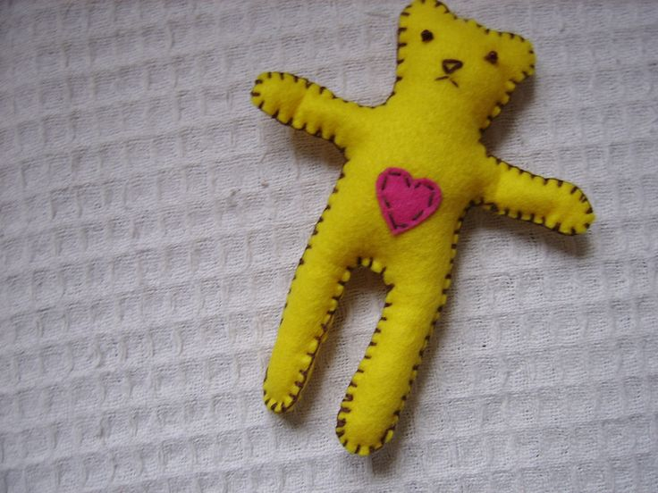 This Toy is made from me from felt, hand sewn and embroidered with cotton   thread, filled with recycled  wood