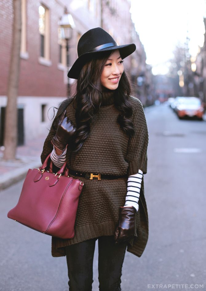 Casual winter outfit - poncho sweater, wool hat, striped shirt