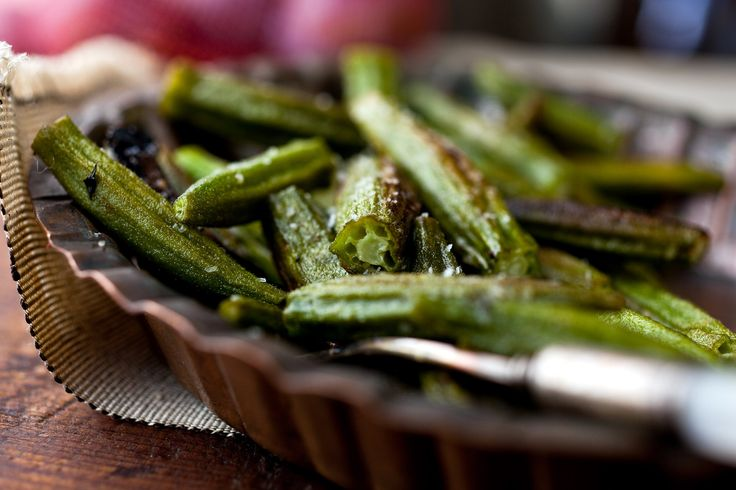 My friend Marian Schwartz gave me the idea to roast okra It's an ingenious strategy: No need to marinate the okra in salt and vinegar beforehand -- it develops a wonderful seared flavor in the hot oven, and it won't be gooey.