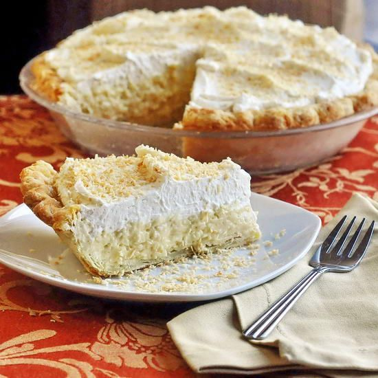 The Absolute Best Coconut Cream Pie - this 40 year old recipe uses whole milk in the filling and is crowned with plenty of real dairy whipped cream. There's no beating an old school, luscious coconut cream pie.