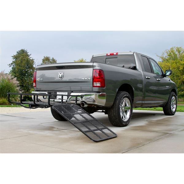 Hitch cargo basket installed on pickup truck with ramp down in loading position
