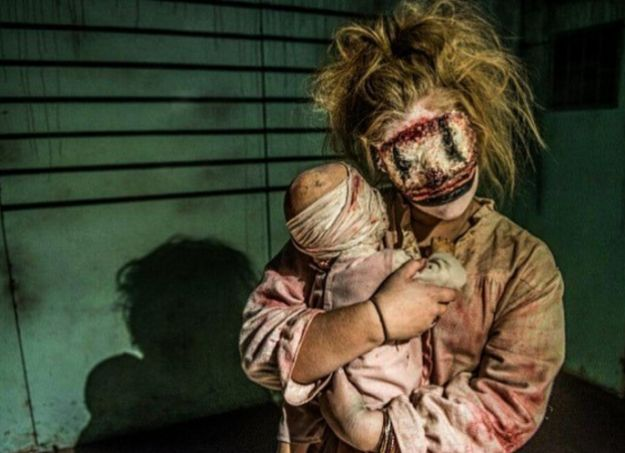 Bloody Mother and Child | 25 Fucking Creepy Costumes That'll Totally Up Your Halloween Game