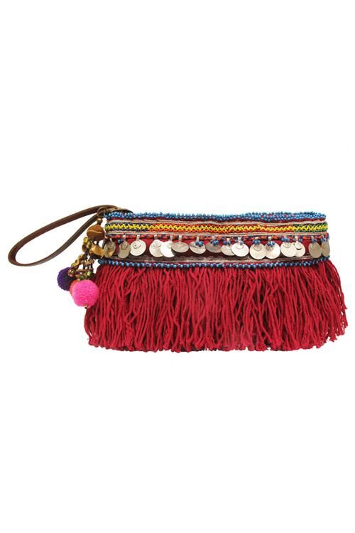 Elliot Mann / Indie Pouch maroon This clutch is the perfect size for all your essentials, complete with a full zip closure and two interior pockets. The coin and fringe detail is uniquely Elliot Mann and is sure to add style to any look. Who knew so much fun could come in such a small package? Each belt detail is reclaimed vintage and will vary from the one pictured. Crochet