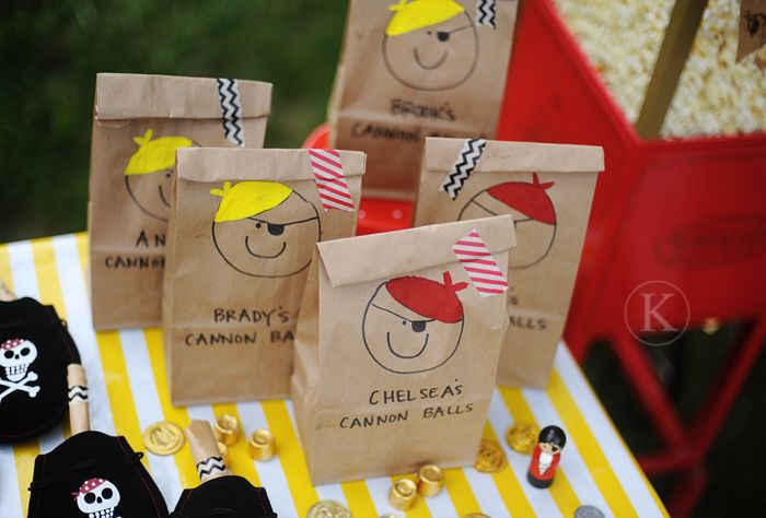 Pirate themed party gift bags. Filled with donut holes. So cute!
