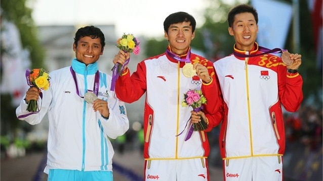 (L-R) Silver medalist Erick Barrondo of Guatemala, gold medallist Chen Ding of China, and bronze medallist Zhen Wang of China celebrate their medals in the Men's 20k Walk on Day 8 of the London 2012 Olympic Games at Olympic Stadium