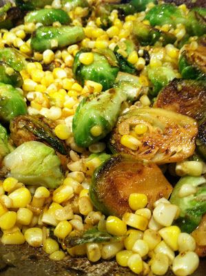 pan seared brussel sprouts & corn with lemon, cayenne pepper, garlic, onion, salt & pepper.