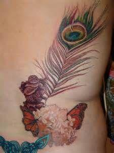 Feminine Peacock Tattoo Design On Back Tattoo 1
