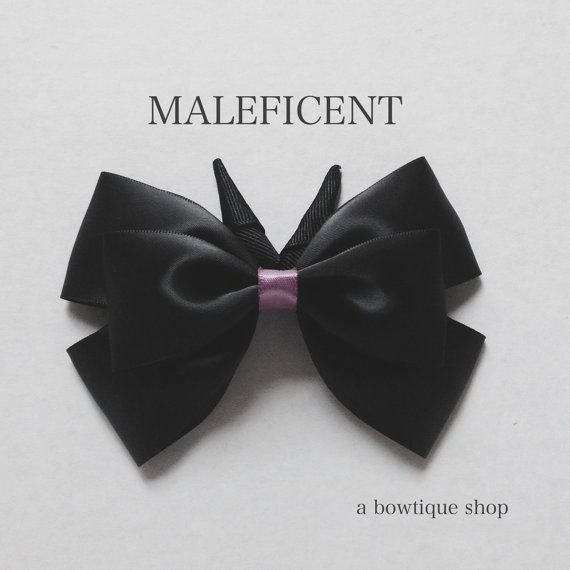 Up for your consideration is a custom made Maleficent hair bow based on the classic story - Sleeping Beauty.    The bow measures 5 inches wide and
