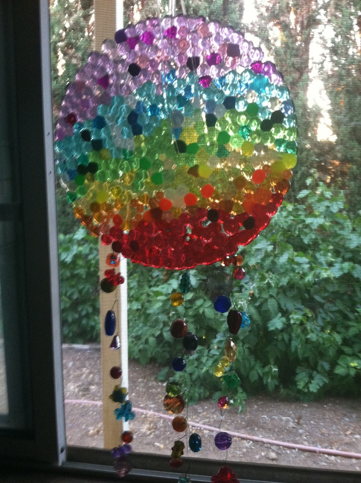 Melted pony bead suncatcher by L Kalama   FYI-melting the beads on the grill makes it so much easier then oven