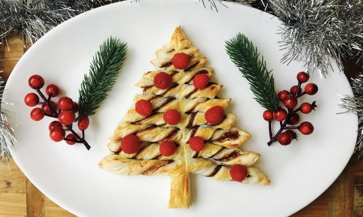 Create a delicious pastry centrepiece for your Christmas buffet this year with this easy Nutella twist Christmas tree.