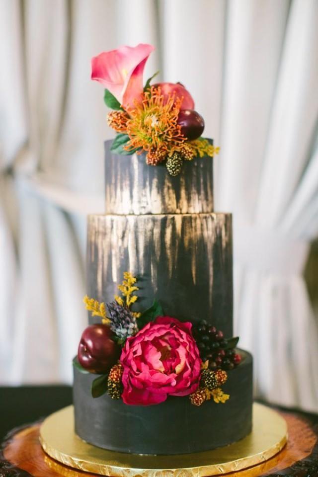 gold and black wedding cake - photo by Ciera Chante Photography http://ruffledblog.com/wedding-ideas-inspired-by-wanderlust