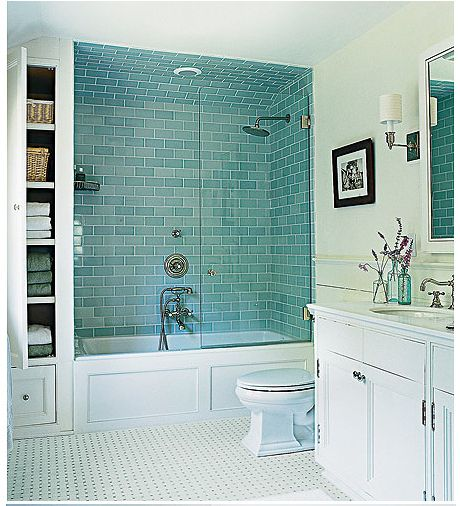 bathroom - bath and shower together.  Hmm, I like the colors, I like the use of space by combining the bath and shower, I like the glass doors.  Could it just be a little bigger maybe?