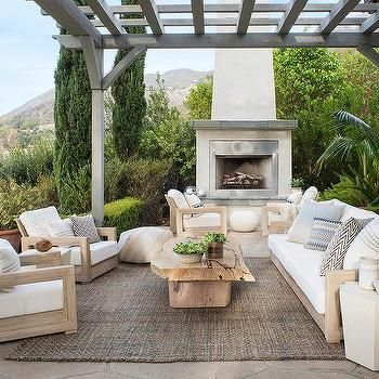 outdoor patio space inspiration - gray wash wood pergola element add so much interest to the space when pared with the neutral color palette of materials and fabrics - outdoor rug add warmth and anchors the space