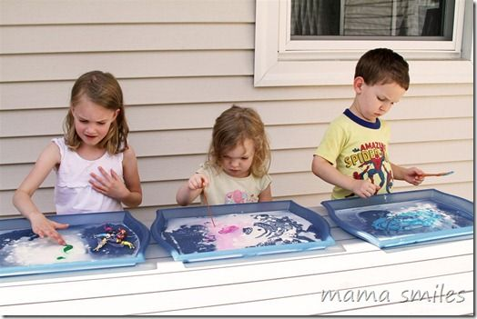 Sensory play with corn starch and water and paint is a wonderful outdoor sensory play activity that cleans up easily.