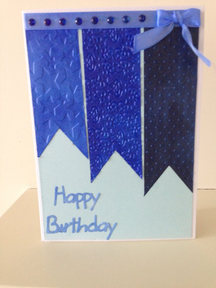 Using sections of banner shaped card embossed with various folders