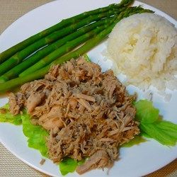 Simmer a pork shoulder roast in a slow cooker for 10 hours with a ginger-spiked sauce for tender and tasty shredded Hawaiian-style pork.