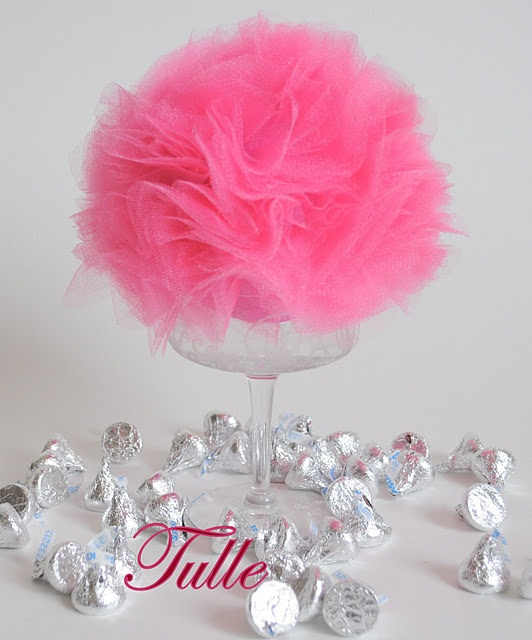 tulle Centerpiece.....I used goblets from my Dollar Tree store. The styrofoam balls are really pricey, $5. for 2. Hobby Lobby had the tulle half price. Made these with white tulle and added a hot pink bow under the stem. Really pretty!