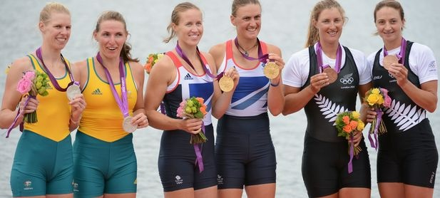 Gold medallists (L-R) Helen Glover and Heather Stanning of Great Britain celebrate on the podium with silver medallists (L-R) Sarah Tait and Kate Hornsey of Australia and bronze medallists (L-R) Rebecca Scown and Juliette Haigh of New Zealand after competing in the Women's Pair Final A  on Day 5 of the London 2012 Olympic Games at Eton Dorney on August 1, 2012 in Windsor, England. © Harry How/Getty Images