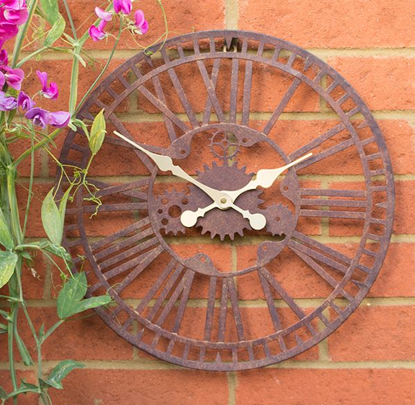 Bring some contemporary style to your outdoor space with this mechanical clock. The visible mechanical wheels will provide some additional intrigue to your home or garden. Features Painted metal - this clock has a long lasting painted finish which will protect this