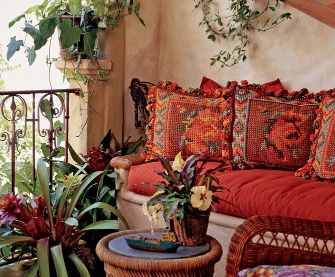 patio built in seating, tomato red cushions and amazing needlepoint pillows
