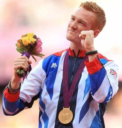 Greg Rutherford receives his gold medal for the Men's Long Jump
