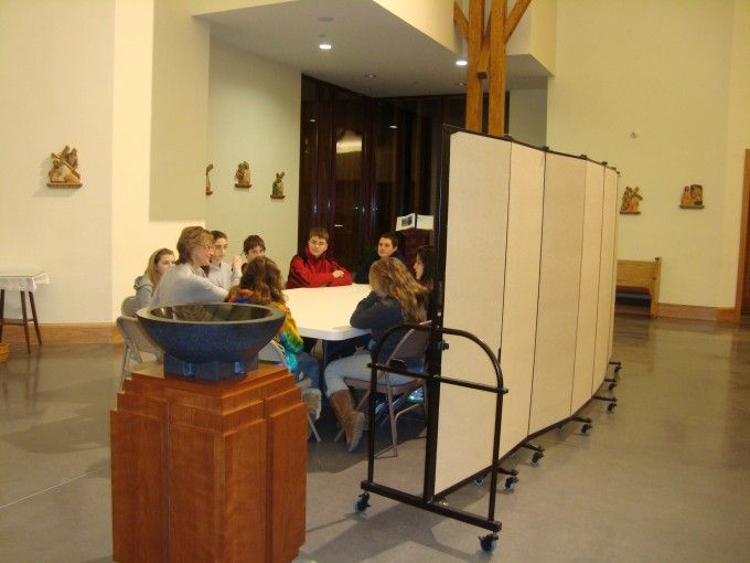 portable room divider creates a temporary classroom within the worship area