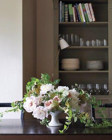 peonies, roses, blueberries, honeysuckle in footed urn