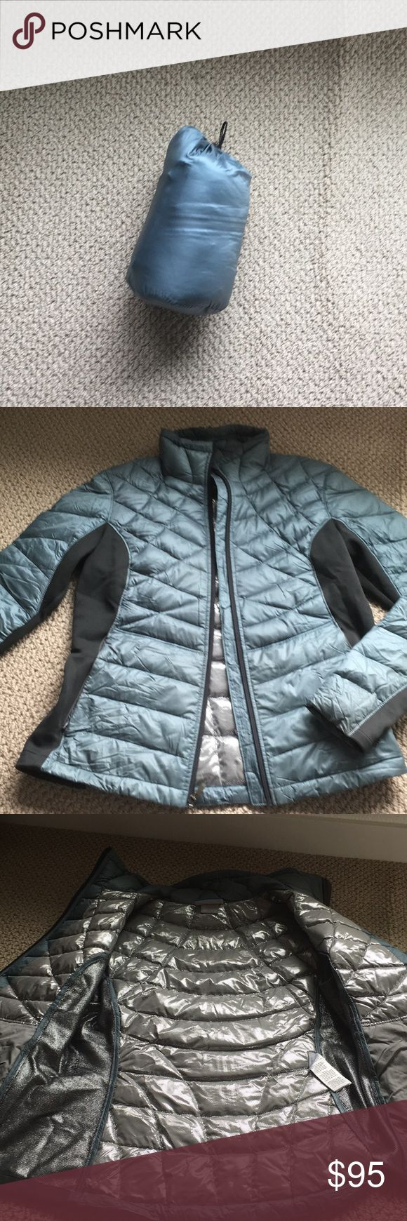 Columbia Down Jacket Like new condition. Worn a couple of times before pregnant and no longer fits. Omni heat so stays really warm. Stretchy material on sides so has a great fit. Comes with stuff sack. From a pet free and smoke free home. Columbia Jackets & Coats Puffers