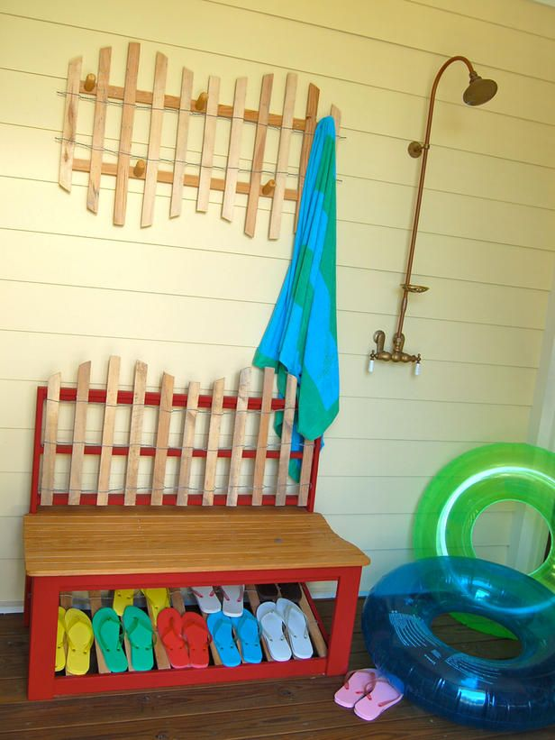 "This Florida vacation home's porch shower is the ideal spot to wash off stray sand. Dubbed the ""flip-flop stop"" by its owner, it's equipped with a towel rack and ample footwear."