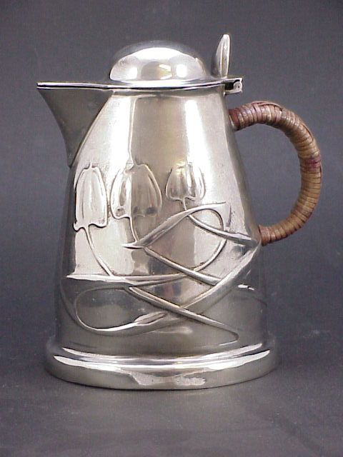 art nouveau pewter hot water jug designs by archibald knox retailed by liberty & co C.1906