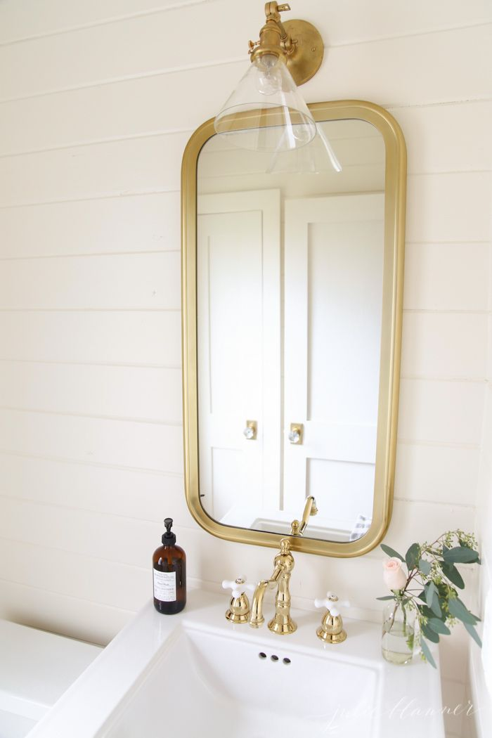 powder-room - Julie Blanner entertaining & design that celebrates life . I used horizontal tongue and groove cedar to make the room appear bigger. Of course painting it in a rich cream never hurts either!