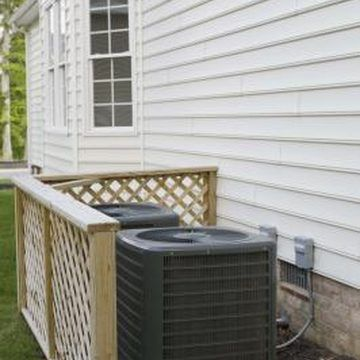 How to Hide an Air Conditioner Screen With a Fence